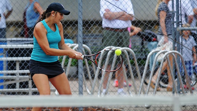 Morgan Brower hits the ball during a women's open doubles match against Sidney Dirks and Michaela Schulz during the Asfora/Clayton South Dakota Adult Open on Saturday, July 26, 2014, at McKennan Park in Sioux Falls, S.D.