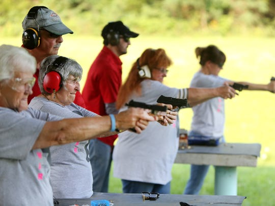 "Members of the ""Women Armed and Ready"" gun club take target practice at the Laughery Valley Fish and Game Shooting Range in Versailles. The new club was started by Konnie Couch and Robin Willoughby in May. Giving instruction are Dale Reatherford, owner of Whitewater Valley Firearms Training and part-time Springdale police officer, left, and Brandon Vornauf, one of the firearms trainers. Barb Maness, 75, second from left, uses a Ruger LC 380. She has her Indiana conceal carry and is getting her Florida conceal carry to allow her to carry in additional states. She said she wanted to learn to shoot for safety reasons after her husband passed away three years ago. She lives in rural Indiana. She said, ""I've been shooting for about two years. I'm surprised at how accurate I am."""
