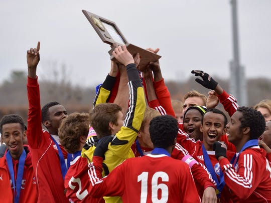 The St. Cloud Apollo Eagles soccer team celebrates its State Class A title after defeating Minneapolis DeLaSalle 1-0 Thursday morning at Husky Stadium in St. Cloud.
