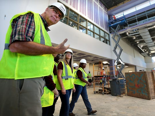 Collierville Schools Superintendent John Aitken (left) leads principals from the school district around the new $94 million high school before it opened in August 2018.
