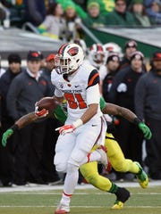 Oregon State's Noah Togiai runs the ball as the Beavers fall to the Ducks 52-42 during Civil War Friday, Nov. 27, 2015, at Autzen Stadium in Eugene, Ore.