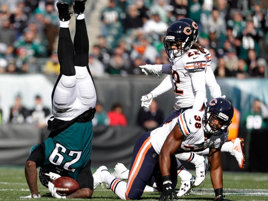 Philadelphia Eagles' LeGarrette Blount (29) is upended by Chicago Bears' Adrian Amos (38) during the first half of an NFL football game, Sunday, Nov. 26, 2017, in Philadelphia. (AP Photo/Michael Perez)