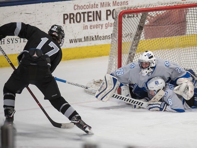 Plymouth's Nathan Stoneburg makes a shot on Salem goali
