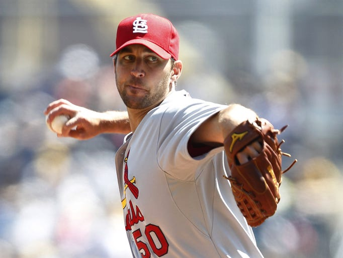 Apr 6, 2014; Pittsburgh, PA, USA; St. Louis Cardinals starting pitcher Adam Wainwright (50) delivers a pitch against the Pittsburgh Pirates during the first inning at PNC Park. Mandatory Credit: Charles LeClaire-USA TODAY Sports