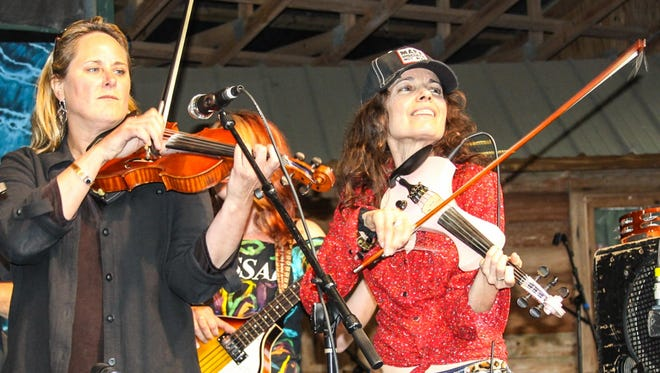 Sue Cunningham, left performs with friend Tara Nevins of Donna The Buffalo at a previous Hickory Fest.