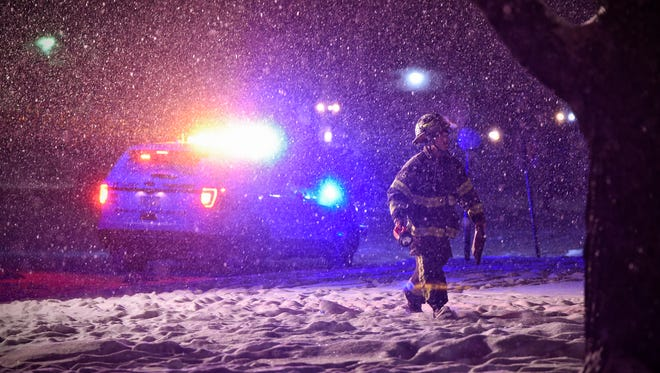 A St. Cloud firefighter responds to the scene of a fire at 1521 Sherburne Drive in St. Cloud Thursday night. The fire was extinguished quickly after firefighters arrived. According to a report the fire was caused by a cigarette and resulted in $60,000 damage to the apartment building.