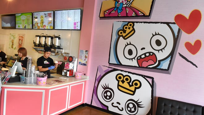 Staff members mix a wide variety of drinks in among the brightly colored decor at ViVi Bubble Tea Wednesday, March 21, in St. Cloud.