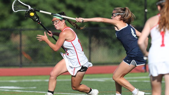 North Rockland's Kerri Gutenberger (13) scores Wednesday