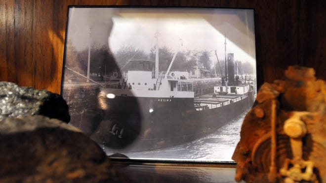 A photograph of the Regina sits with artifacts recovered from her wreck as part of the Storm of 1913 exhibit at the POrt Huron Museum. The Port Huron Museum is hosting a Chautauqua based on the Storm of 1913. The event runs from 10 a.m. to 10 p.m. at McMorran.