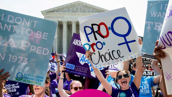 epa05394603 Pro-choice supporters celebrate outside the Supreme Court after the court's ruling in Whole Woman's Health v. Hellerstedt, a case that imposes heavy restrictions on abortion clinics in Texas in Washington, DC, USA, 27 June 2016. The Supreme Court ruling struck down the requirement of doctors to have admitting privileges at local hospitals, among other restrictions.  EPA/MICHAEL REYNOLDS ORG XMIT: MR10