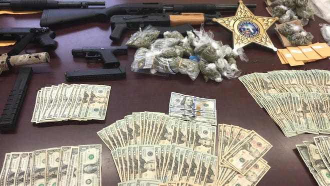 A six-week investigation led to a SWAT team take down of five people, the seizure of over 4 pounds of marijuana, over 100 prescription pills and Ecstasy tablets, 10 firearms and over $10,000 in cash at a Tharpe Street apartment complex.