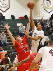 Nahjor Mack of Elmira goes up for a shot as Binghamton's