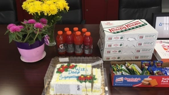 Cake, flowers, doughnuts and cards were among the items dropped off at area police departments in the wake of the Dallas shootings