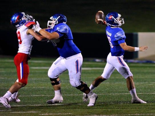 Cooper High School quarterback Ender Freeman throws