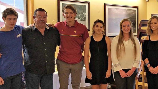 Standing with Board Chairman Dickie Clayton, second from left, and members Darien Ross, Don McMasters and Jeff  West, far right, recipients of scholarships are from left, Austin Mowell, Brooks Jarrell, Sara McMasters, Kristie Gallacher, Ashton Munoz, Jacali Baeza and Christina Fragoso.