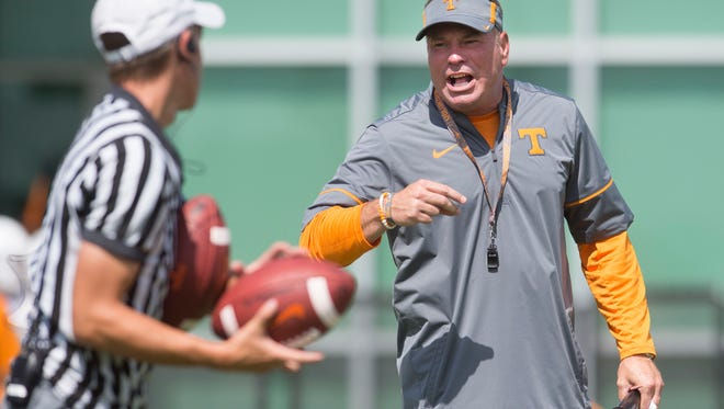 Tennessee Head Coach Butch Jones yells during a University of Tennessee fall football practice at Anderson Training Facility in Knoxville, Tenn. on Friday, Aug. 18, 2017.