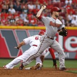 Arizona Diamondbacks second baseman Aaron Hill (2) throws to first after forcing out Cincinnati Reds center fielder Ryan LaMarre (65) at second base in the second inning at Great American Ball Park.