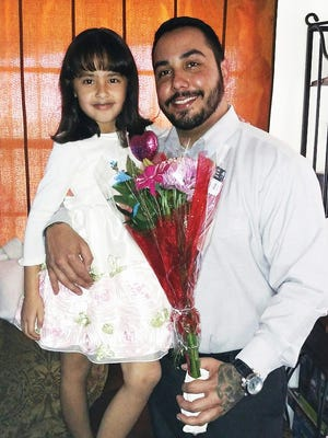 Richard Madrigal is shown with his daughter, Mikayla Marie Madrigal, on a father-daughter date.