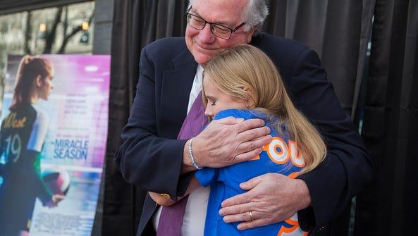 Ernie Found, father of Caroline Found, hugs actress