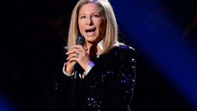 FILE - In this Oct. 11, 2012, file photo, singer Barbra Streisand performs at the Barclays Center in the Brooklyn borough of New York. Streisand is launching a multiple-city tour this summer. Streisand's manager said Monday, May 16, 2016, the entertainer will appear at arenas across the country. (Photo by Evan Agostini/Invision/AP, File)