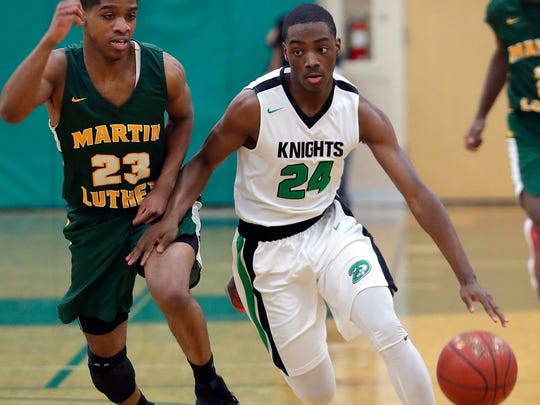 Dominican's Gacoby Jones (24) dribbles past Martin Luther's Ki-Anthony Blake during the boys basketball game between Dominican and Martin Luther at Dominican in Whitefish Bay, Friday, January 19, 2018.