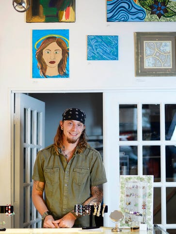 Dustin Nispel, one of three owners, stands inside The