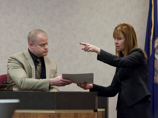 Assistant Prosecuting Attorney Mary Kelly shows evidence to New Baltimore Police Officer Thomas Johannes as she points to Jess Bowman Tuesday, Jan. 3, 2015 in the courtroom of Judge Cynthia Lane at the St. Clair County Courthouse. Bowman is charged with open murder and felony firearm in the August 2014 death of Timothy Belisle.