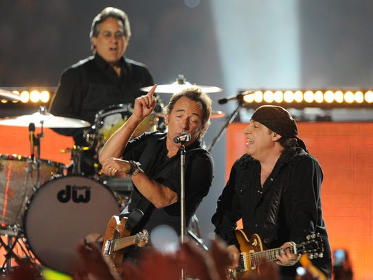 Max Weinberg (left to right), Bruce Springsteen and