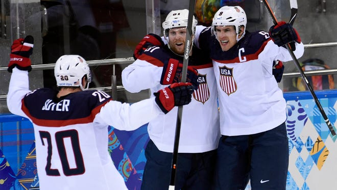 Team USA's Zach Parise (9) celebrates with forward Phil Kessel (81) and Ryan Suter (20) after scoring during the quarterfinals against the Czech Republic.