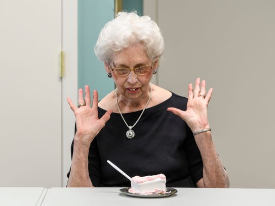Doris Bedillion, 88, awes over her large piece of vanilla
