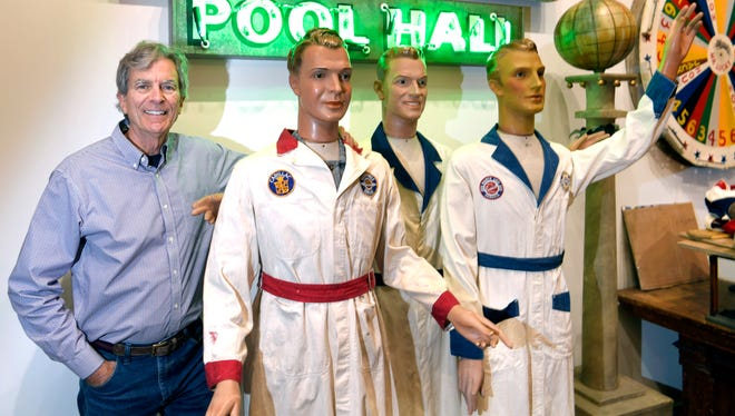Preservationist Bill Powell stands with mannequins from 1938 in his new downtown Franklin antique store. Powell has been working on houses and pieces of downtown for years. He is now opening a business where he most recently restored a strip of buildings in downtown Franklin.