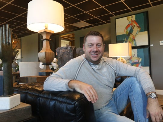 Brad Anderson, owner of Designers 2 in Plover, has recently expanded his business by almost 50 percent to incorporate more items for sale. He is seen in the newly built area of his biusiness September 29, 2016.