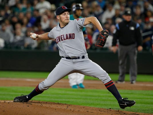 Cleveland Indians starting pitcher Trevor Bauer throws to a Seattle Mariners batter during the first inning of a baseball game, Friday, Sept. 22, 2017, in Seattle. (AP Photo/Ted S. Warren)