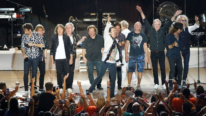 Members of the band Foreigner thank the crowd at the end of their Aug. 4, 2018, show at the Buffalo Chip campground outside Sturgis during the 2018 motorcycle rally.