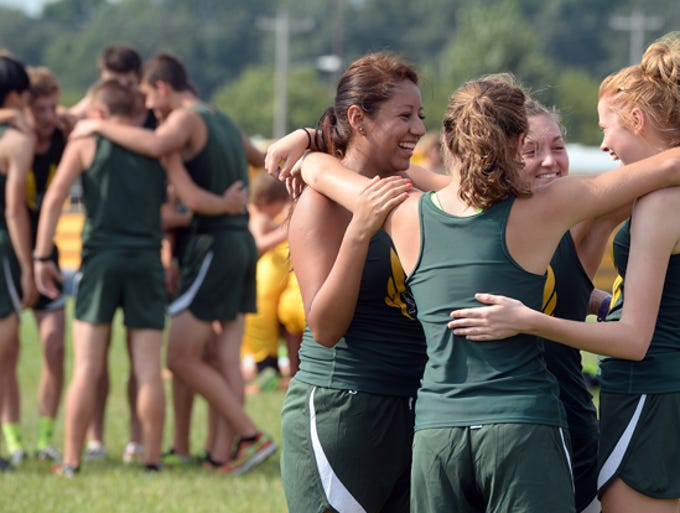 Runners from Northeastern High School prepare to compete in the cross country Hokum at Hagerstown Tuesday, Aug. 19, 2014.