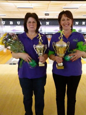 Robin Pangallo (right) and Kathy Watts (left) pose with their first and second place trophies respectively.