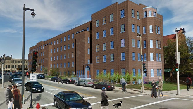 A rendering of the planned mixed-use apartment building where the nearby St. Ben's Clinic may be relocated.