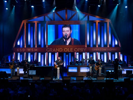 Chris Young performs at the Grand Ole Opry House in Nashville on Aug. 29, 2017.