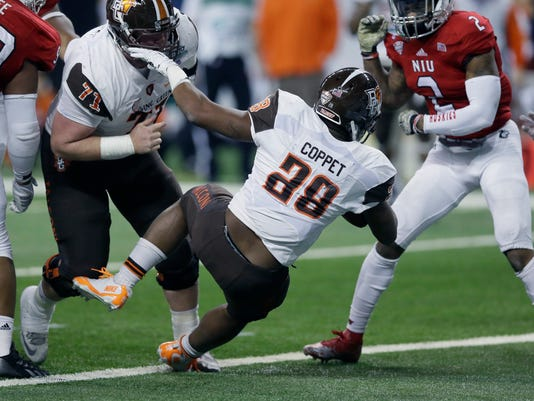 Bowling Green running back Fred Coppet falls into the end zone to score a touchdown during the first half of the Mid-American Conference championship NCAA college football game against Northern Illinois, Friday, Dec. 4, 2015, in Detroit. (AP Photo/Carlos Osorio)