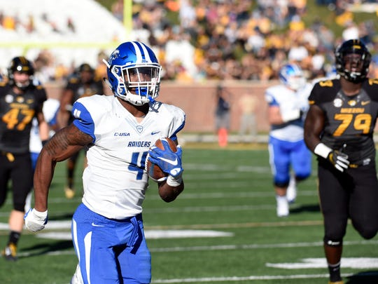 Middle Tennessee State running back I'Tavius Mathers runs for a 71-yard touchdown against Missouri on  Oct. 22, 2016.