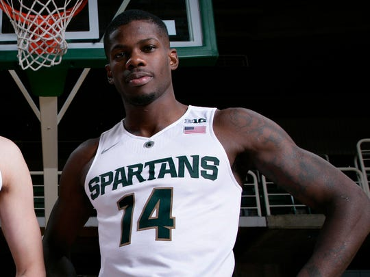 Michigan State's Eron Harris poses for a photo during