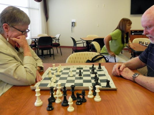 Menno Haven residents compete against one another at the first Generation Chess meeting on Aug. 28.