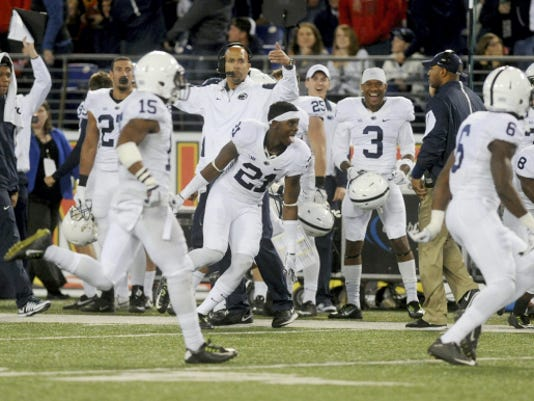The Penn State sideline celebrates during the Nittany Lions' 31-30 victory over Maryland in Baltimore on Saturday.