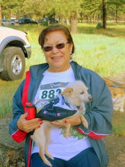 One little guy will get a free ride for much of the walk during the Wandering Paws event.