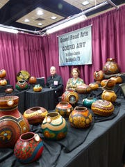 Incredible gourds took center stag in the Gravel Road Arts booth.