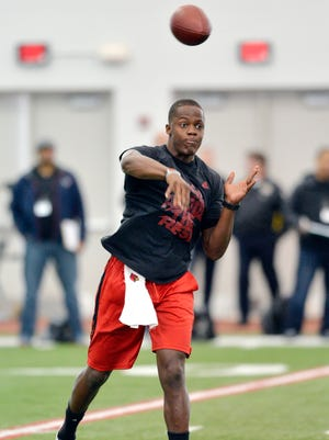 Louisville quarterback Teddy Bridgewater participates in a passing drill during his pro day at the University of Louisville in Louisville on Monday, March 17, 2014.