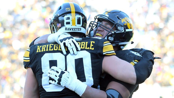 Iowa tight end Henry Krieger Coble (80) celebrates after his touchdown with teammate Matt VandeBerg (89) during the Hawkeyes' 40-20 win over Purdue on Nov. 21. Iowa has had a dream season at 12-0, though national respect has come slowly.