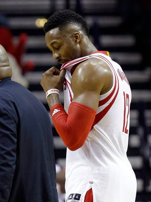 Houston Rockets' Dwight Howard leaves the court after receiving a second technical foul against the Washington Wizards in the second half of an NBA basketball game Saturday, Jan. 30, 2016, in Houston.