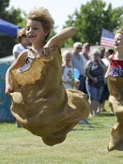 Lux Tate, 7, catches some air as she dashes to first