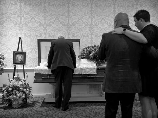Fred Shultz spends his last moments with his wife of 51 years, Patty, after her funeral at Alexander Funeral Home in Newburgh Sept. 15, 2017.